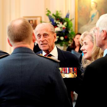 Britain's Prince Philip meets veterans and serving RAF personnel during a pre-lunch reception at the RAF Club in central London to mark the 75th anniversary of the Battle of Britain. Photo: Steve Parsons/PA Wire