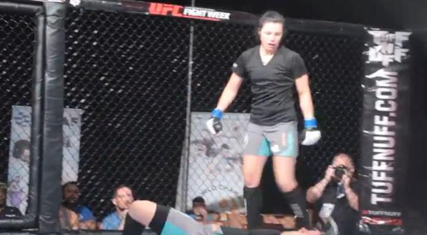 Sinead Kavanagh stand over her opponent after delivering a knockout blow