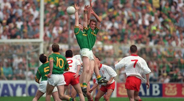 John McDermott and Jimmy McGuinness, Meath, contest a high ball during their All-Ireland Football Semi-Final with Tyrone in 1996