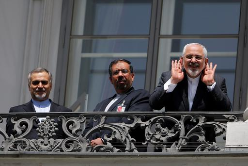 Iranian Foreign Minister Mohammad Javad Zarif (R) talks to media from a balcony of the Palais Coburg hotel where the Iran nuclear talks are being held in Vienna. Photo: Getty Images