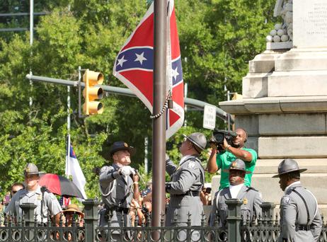 The Confederate battle flag is permanently removed from the South Carolina statehouse grounds during a ceremony in Columbia, South Carolina. Photo: Reuters