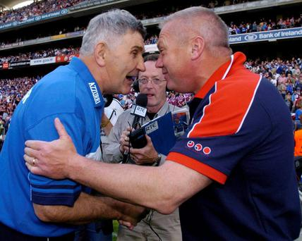 Páidí Ó Sé shakes hands with Mick O'Dwyer after Westmeath's victory over Laois in the 2004 Leinster Senior Football Championship final at Croke Park DAVID MAHER / SPORTSFILE