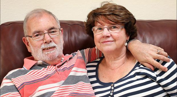 Carer Marie Magennis with husband Dave relaxing at home. PHOTO BY STEVE HUMPHREYS.