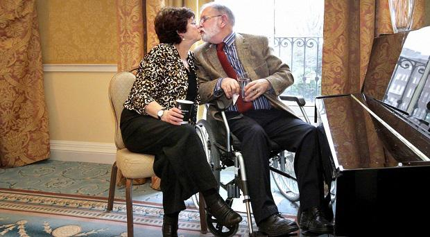 Marie and Dave share a kiss at the Shelbourne Hotel where Marie was presented with her long-time carer award