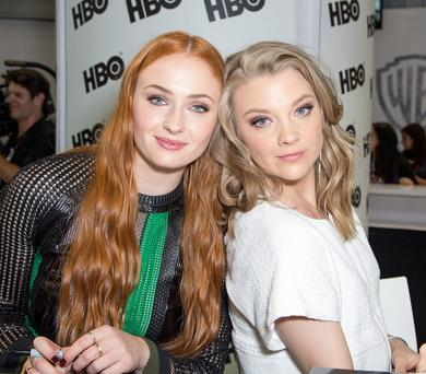 SAN DIEGO, CA - JULY 10: Actresses Sophie Turner (L) and Natalie Dormer attend a fan signing for 'Game of Thrones' during Comic-Con International on July 10, 2015 in San Diego, California. (Photo by Chelsea Lauren/WireImage)