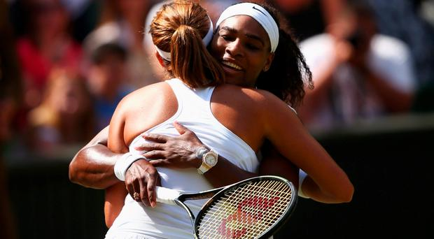 Serena Williams of the United States celebrates after winning the Final Of The Ladies' Singles against Garbine Muguruza of Spain during day twelve of the Wimbledon Lawn Tennis Championships