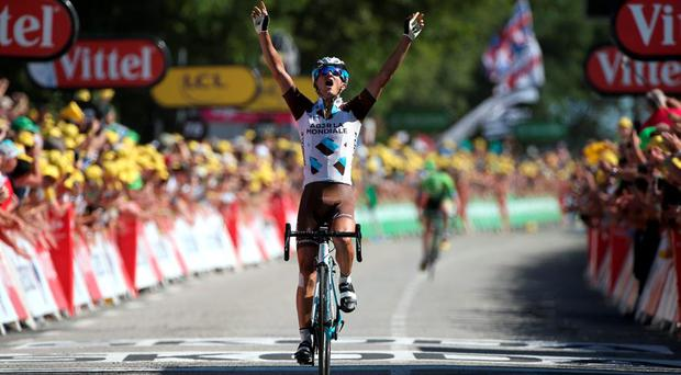 Alexis Vuillermoz of France and AG2R La Mondial Team celebrates victory as he crosses the finish line to win stage eight of the 2015 Tour de France, a 181.5km stage between Rennes and Mur de Bretagne o