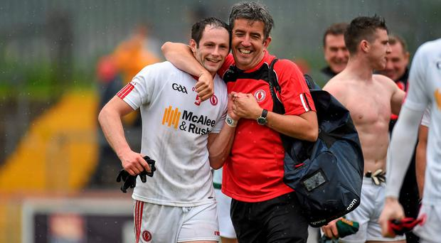 11 July 2015; Ronan McNabb, Tyrone, celebrates with member of the Tyrone backroom staff Michael McCahey after the game. GAA Football All-Ireland Senior Championship, Round 2B, Tyrone v Meath, Healy Park, Omagh, Co. Tyrone. Picture credit: Paul Mohan / SPORTSFILE