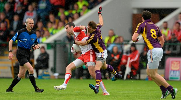 11 July 2015; Caolan O'Boyle, Derry, in action against Adrian Flynn, Wexford. GAA Football All-Ireland Senior Championship, Round 2B, Derry v Wexford, Owenbeg, Derry. Picture credit: Oliver McVeigh / SPORTSFILE