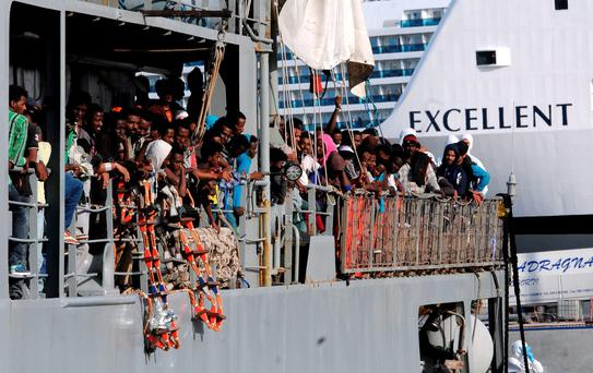 Migrants wait to disembark from the Irish naval ship at the Palermo harbor, Italy, June 30. The crew of the Le Eithne saved 164 children among the almost 3,400 migrants it has rescued since mid-May (AP Photo/Alessandro Fucarini)