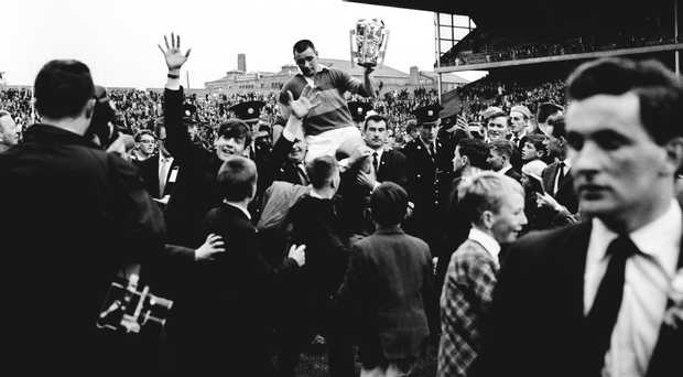 Tipperary v Wexford - All Ireland Hurling Final 1965; Tipperary's Jimmy Doyle holds the Liam MacCarthy Cup as he is held aloft by Tipperary supporters after his side's vitory over Wexford