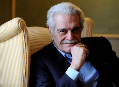 Egyptian actor Omar Sharif poses for a photograph during the presentation of his film