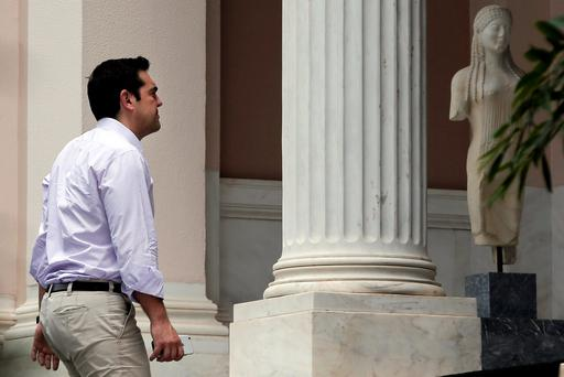 Greek Prime Minister Alexis Tsipras arrives at his office in Maximos Mansion in Athens