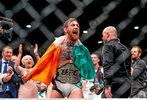 Conor McGregor celebrates after defeating Chad Mendes. Photo: Esther Lin / Sportsfile