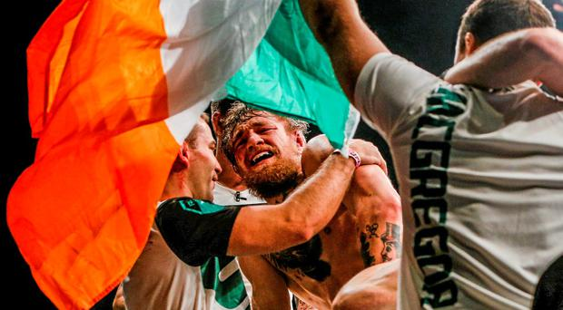 Conor McGregor celebrates with team-mate Artem Lobov after defeating Chad Mendes. Photo: Esther Lin / Sportsfile