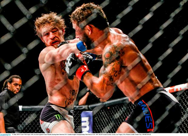 Conor McGregor in action against Chad Mendes during their Interim UFC Featherweight Championship Title bout at UFC 189. MGM Grand Garden Arena, Las Vegas. Photo: Esther Lin / Sportsfile