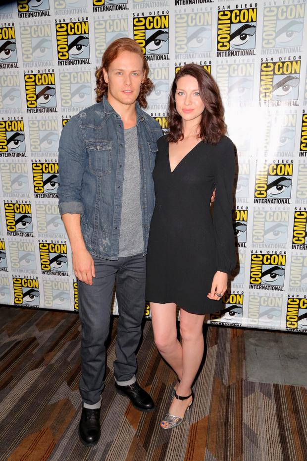 Actors Sam Heughan (L) and Caitriona Balfe attend the