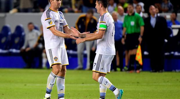 Robbie Keane of the LA Galaxy (R) celebrates with Steven Gerrard (L) after scoring the equaliser against Club America off a pass from Gerrard, the ex-Liverpool and England international on his debut for the MLS side against Club America during their 2015 International Champions Cup match in Carson, California.