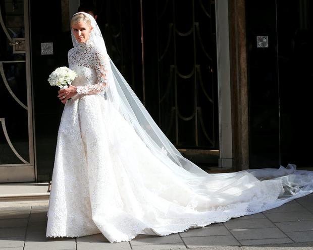84421a1261 The price of love  Nicky Hilton s Valentino wedding dress cost €70k ...
