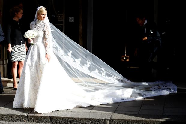 459b3880cc ... Valentino wedding dress cost €70k. Nicky Hilton seen leaving Claridge s  Hotel on her wedding day on July 10