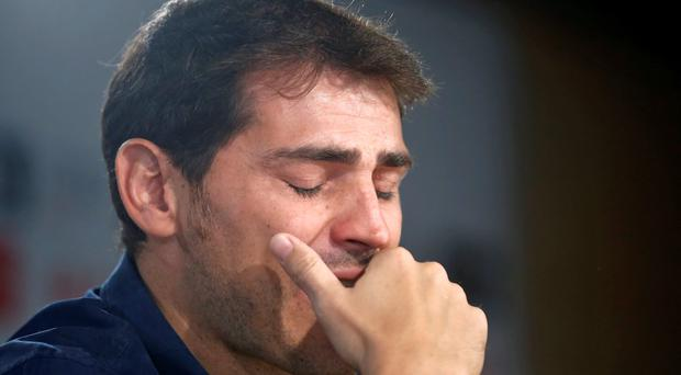 Departing Real Madrid captain and goalkeeper Iker Casillas cries as he tries to read a statement at Santiago Bernabeu stadium in Madrid