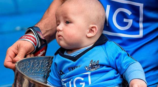 12 July 2015; Five month old Aidan Bastick, son of Dublin footballer Denis Bastick is carried in the Delaney Cup after the game. Leinster GAA Football Senior Championship Final, Westmeath v Dublin, Croke Park, Dublin. Picture credit: Brendan Moran / SPORTSFILE