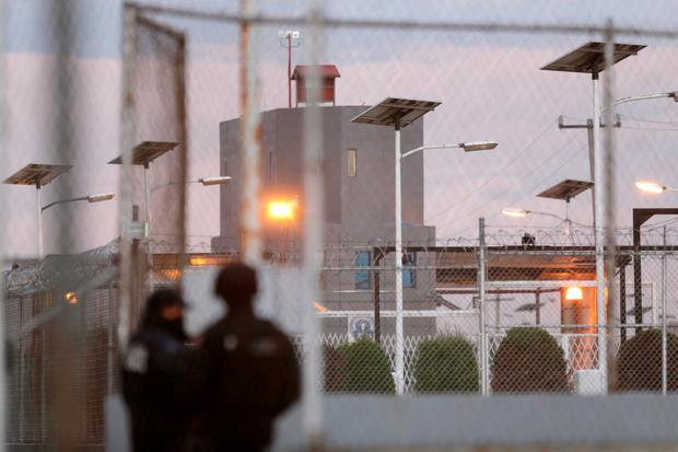 Police keep watch outside the Altiplano Federal Penitentiary, after drug lord Joaquin