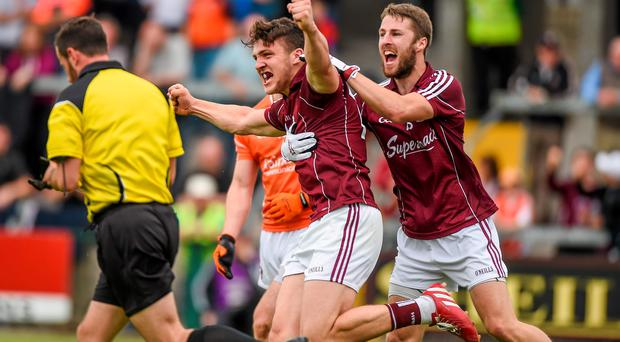 12 July 2015; Damien Comer, Galway, celebrates after scoring the first goal against Armagh with team-mate Michael Lundy. GAA Football All-Ireland Senior Championship, Round 2B, Armagh v Galway, Athletic Grounds, Armagh. Picture credit: Matt Browne / SPORTSFILE