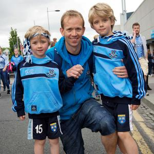 12/07/2015. Pictured are (LtoR) Tiernan Walsh, 6 with his Dad, John and brother Oisin, 8 from Kilmacud after Dublin beat Westmeath in the Leinster football final at Croke Park. Photo: El Keegan