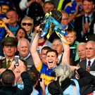 Tipperary captain Brendan Maher lifts the cup following his side's victory