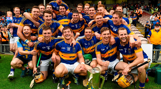 Tipperary players celebrate with the cup