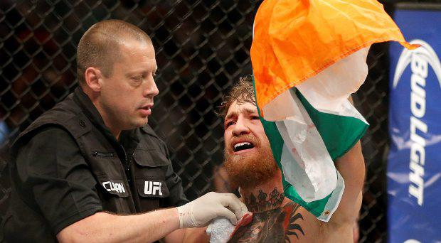 Conor McGregor reacts after defeating Chad Mendes during their interim featherweight title mixed martial arts bout at UFC 189 on Saturday, July 11, 2015, in Las Vegas. (AP Photo/John Locher)