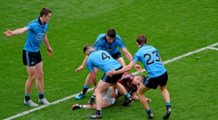 James Dolan finds himself isolated and surrounded by Dublin players Philip McMahon, Diarmuid Connolly, and Michael Fitzsimons