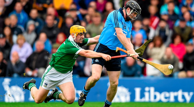 Limerick's Seanie O'Brien breaks his hurley as he attempts to block David O'Callaghan's shot