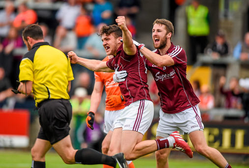 Galway's Damien Comer celebrates after scoring the first goal against Armagh with team-mate Michael Lundy