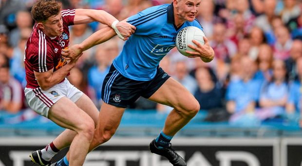 Dublin's Ciaran Kilkenny attempts to break away from the clutches of Westmeath's Ger Egan.