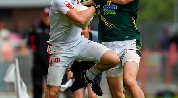 Meath's Michael Newman attempts to force Tyrone's Cathal McCarron over the line in Saturday's qualifier at Healy Park, Omagh