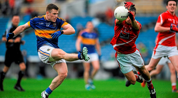 Tipperary's Ger Mulhair has his effort blocked down by Louth's Pádraig Rath during Saturday's qualifier