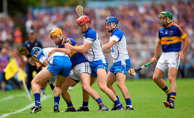 Waterford players (l-r) Michael Walsh, Eddie Barrett and Colin Dunford in action against Tipperary's Kieran Bergin