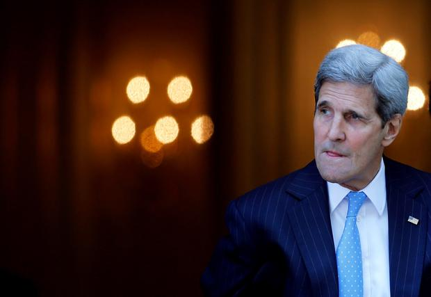 U.S. Secretary of State John Kerry leaves his hotel in Vienna, Austria as the nuclear talks drag on (REUTERS/Carlos Barria)
