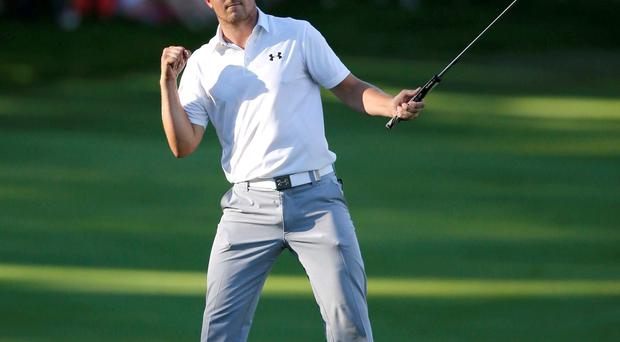 Jordan Spieth celebrates his birdie on the 18th green during the third round of the John Deere Classic golf tournament