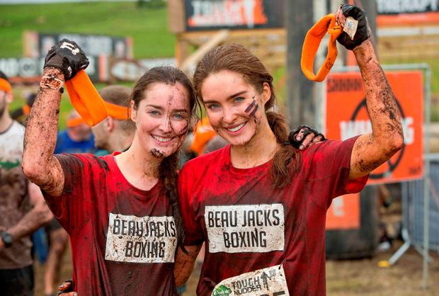 Pictured is Rachel Purcell and Roz Purcell after battling it through the gruelling obstacles at the Tough Mudder event which takes place over the weekend in Loughcrew Adventure Centre, Co. Meath.