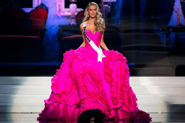Newly crowned Miss USA Olivia Jordan of Oklahoma walks in her evening gown on stage during the 2015 Miss USA beauty pageant