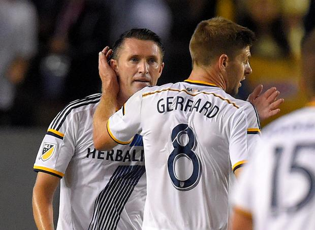 Los Angeles Galaxy forward Robbie Keane, left, is congratulated by midfielder Steven Gerrard, of England, after scoring during the first half of an International Champions Cup soccer match against Club America, Saturday, July 11, 2015, in Carson, Claif. (AP Photo/Mark J. Terrill)