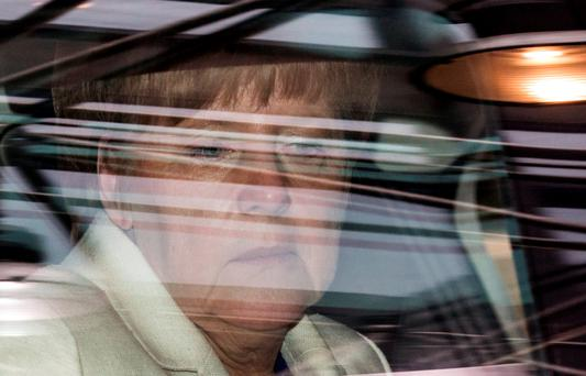 German Chancellor Angela Merkel arrives in her car at a euro zone leaders summit in Brussels, Belgium, July 12, 2015. Euro zone leaders will fight to the finish to keep near-bankrupt Greece in the euro zone on Sunday after the European Union's chairman cancelled a planned summit of all 28 EU leaders that would have been needed in case of a