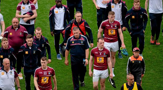 A dejected Westmeath manager Tom Cribben leaves the field after the game