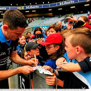 12 July 2015; Dublin captain Stephen Cluxton signs autographs for young fans after the game. Leinster GAA Football Senior Championship Final, Westmeath v Dublin, Croke Park, Dublin. Picture credit: Tom?s Greally / SPORTSFILE