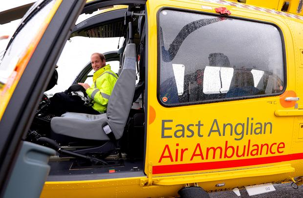 The Duke of Cambridge sits in the cockpit of a helicopter as he begins his new job with the East Anglian Air Ambulance (EAAA) at Cambridge Airport.