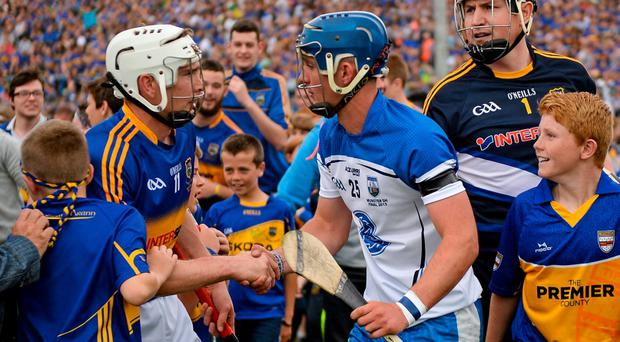 Tipperary's Brendan Maher shakes hands with Waterford's Patrick Curran after the game