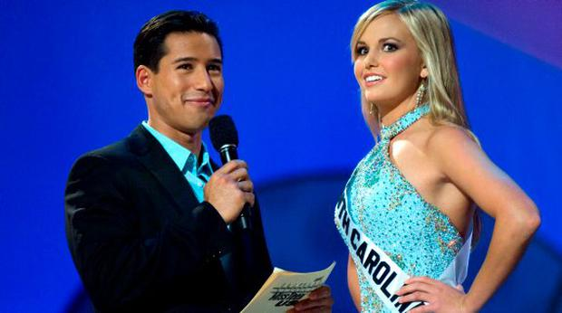 Lauren Caitlin Upton, Miss South Carolina answering a question from host Mario Lopez, left, during the interview portion of the Miss Teen USA 2007 competition